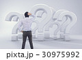 Asian Man Standing In Front of Big Question Mark 30975992