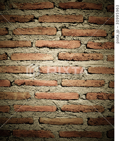 Old brick wall texture in a background image 30995963