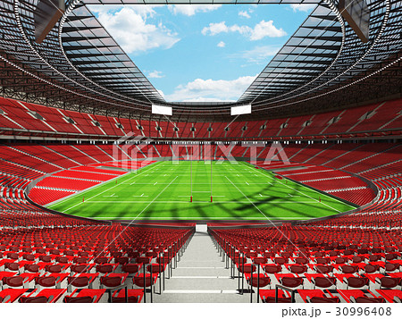 Beautiful modern rugby stadium with red seats 30996408