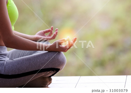 close up of young girl doing yoga lotus poseの写真素材
