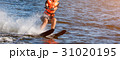 Woman riding water skis closeup. Body parts 31020195