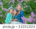 Mother woman with two cute smiling girls sisters 31031024
