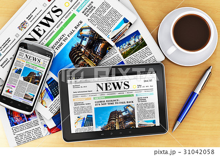 Tablet computer, smartphone and newspapers 31042058