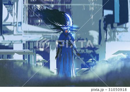 woman in a blue dress standing in futuristic city 31050918