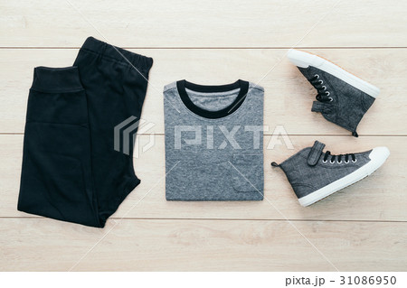 T-shirt with pants and shoes on wooden backgroundの写真素材 [31086950] - PIXTA