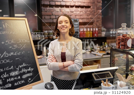 happy woman or barmaid at cafe counterの写真素材 [31124920] - PIXTA