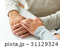 close up of old man and young woman holding hands 31129324