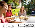 happy friends having dinner at summer garden party 31129332