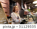 happy woman or barmaid at cafe counter 31129335