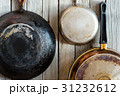 pans hanging on a wooden wall 31232612