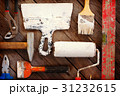Industrial and painting tools on a wooden surface. 31232615