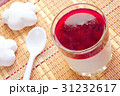 cherry jelly in a glass, a spoon and cookies 31232617