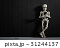 A skeleton leaning on a wall with smartphone 31244137