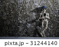 A skeleton leaning on a wall with smartphone 31244140