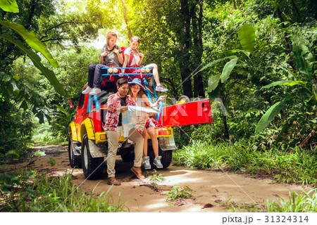Happy asian young travellers with car off road 31324314