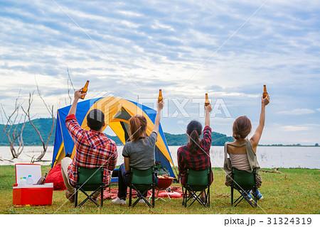 Group of man and woman enjoy camping picnic 31324319