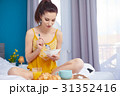 Young beautiful woman having breakfast in bed. 31352416
