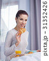Young beautiful woman having breakfast in bed. 31352426