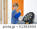 Little cute blond preschool kid boy playing dart 31363404