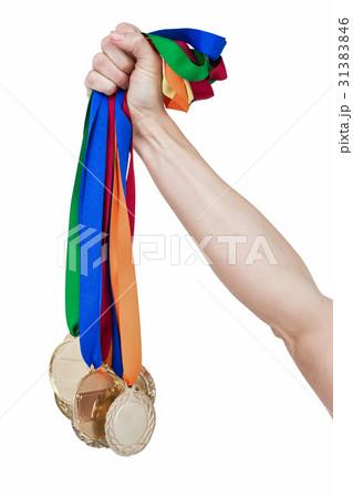 Close up of a hand holding medalsの写真素材 [31383846] - PIXTA