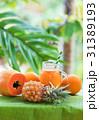 Tropical exotic pineapple papaya fruits juice 31389193