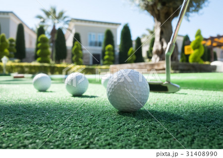 Mini golf scene with ball and club 31408990
