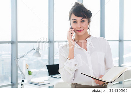 Happy smiling businesswoman having a business call 31450562