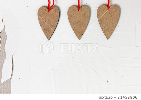 Three handmade wooden hearts on old plaster wallの写真素材 [31453806] - PIXTA