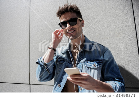 Cheerful smiling male person using phone 31498371