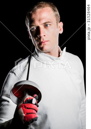 Close-up of swordsman holding fencing sword 31526464