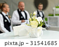 Blurred background, professional waiters standing 31541685