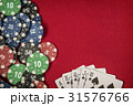 Gambling chips and card for poker on red felt 31576766
