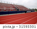 Red track in front of red and blue bleachers 31593301