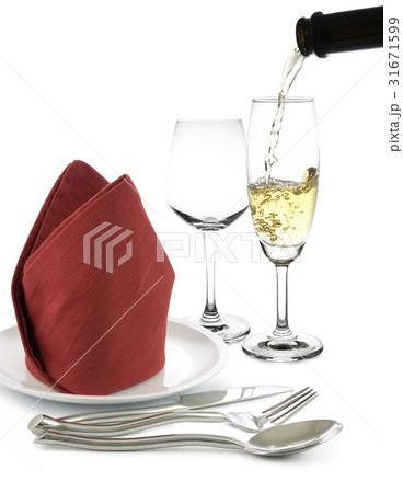 fork and knife on white napkin and wine glassesの写真素材 [31671599] - PIXTA