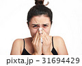 headshot of woman with flu 31694429
