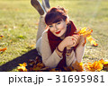 Girl lying on ground with yellow leaves 31695981