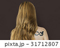 Young Adult Woman Back with Tattoo Studio Portrait 31712807