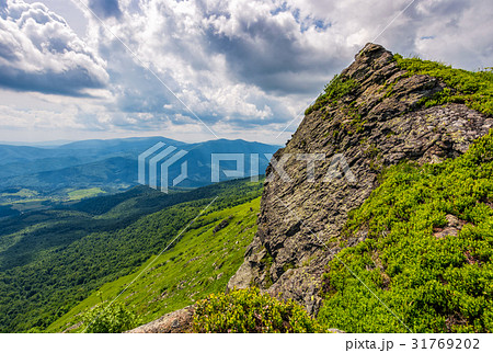 huge boulder on the edge of a hill 31769202