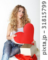 Blond girl with big valentine card 31815799