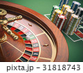 Casino roulette wheel with casino chips on green 31818743