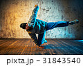 Man dancing on wall background 31843540
