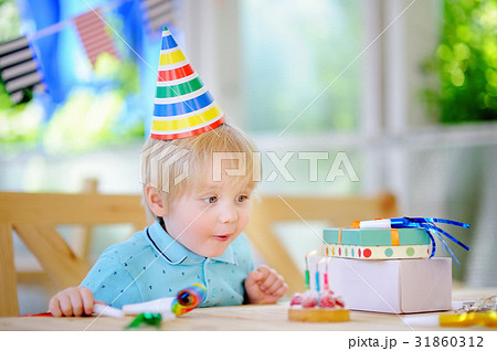 cute little boy celebrate birthday party with colorful decoration
