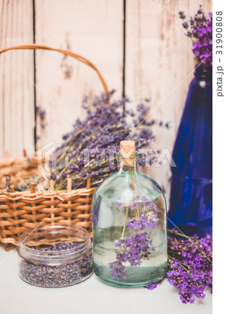 Lavender oil with fresh flowers on woodenの写真素材 [31900808] - PIXTA