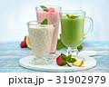 Different  milkshakes on the table. 31902979