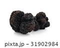Black truffles on white. 31902984