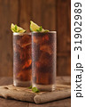 Glass of cola with ice. 31902989