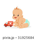 Sweet happy baby sitting and playing with toy car 31925684