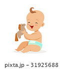 Adorable happy baby in a diaper sitting and 31925688