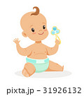 Sweet little baby sitting and playing with rattle 31926132