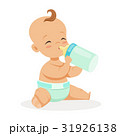 Sweet little baby sitting and drinking milk in a 31926138